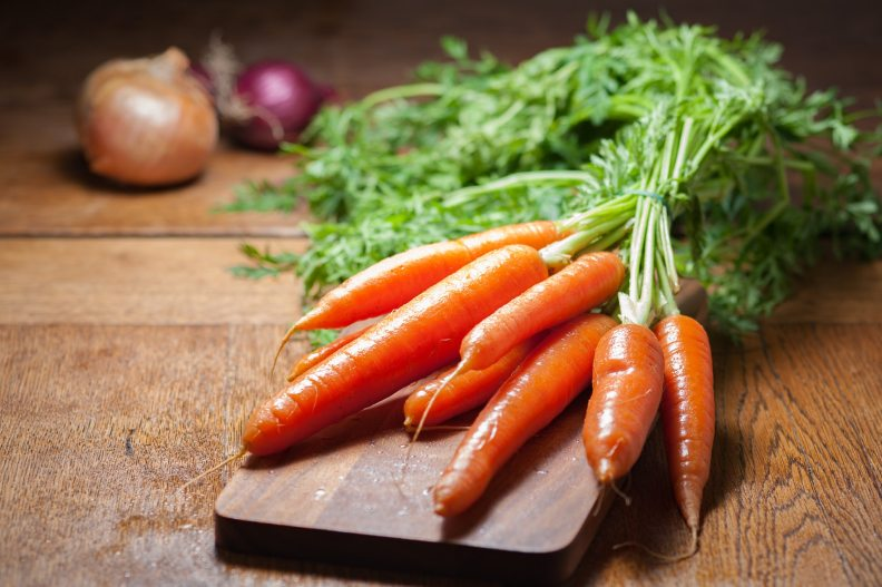 carrots-on-cutting-board-in-kitchen